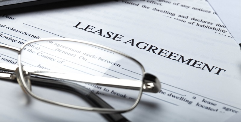 Glasses resting on lease agreement document