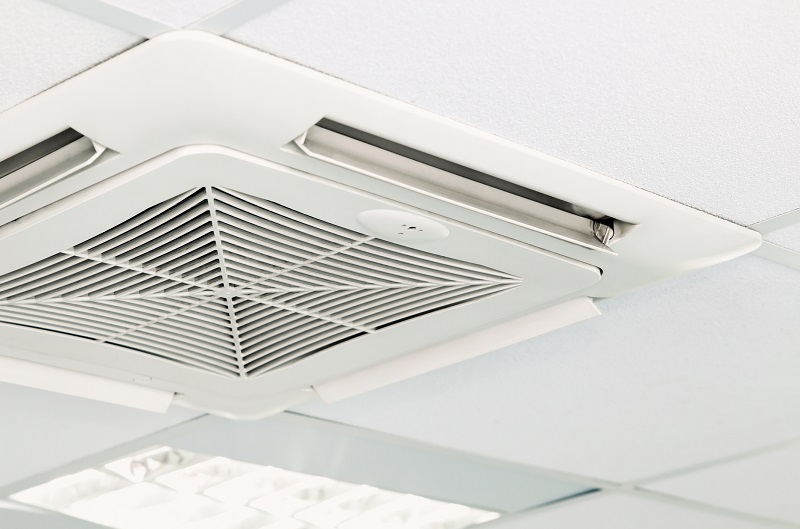 Air conditioning system unit in office ceiling